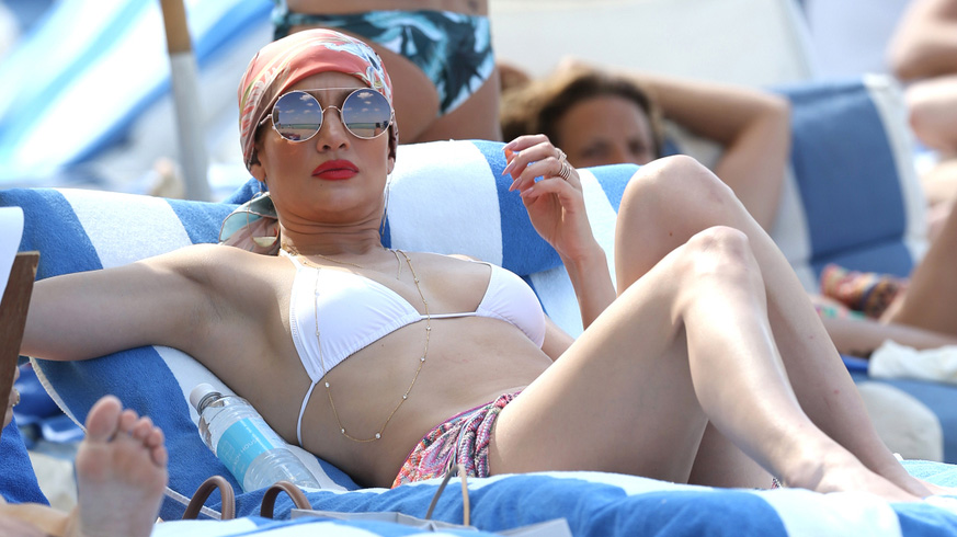 Jennifer Lopez relaxes ahead of Mother's Day showing off her amazing figure in a white bikini on Miami Beach